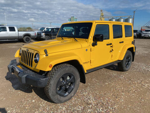 2015 Jeep Wrangler Unlimited for sale at Truck Buyers in Magrath AB