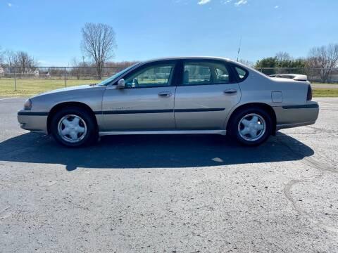 2001 Chevrolet Impala for sale at Caruzin Motors in Flint MI