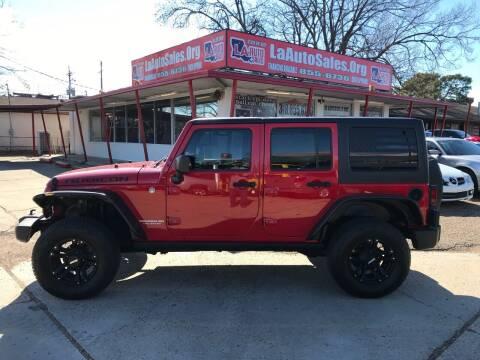 2011 Jeep Wrangler Unlimited for sale at LA Auto Sales in Monroe LA