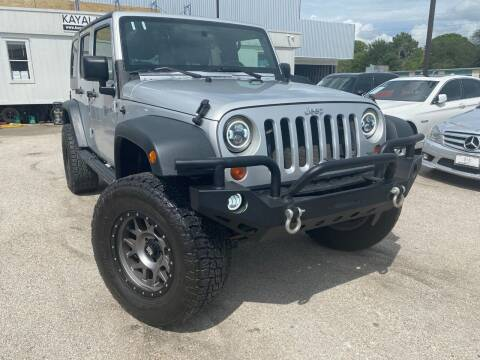 2009 Jeep Wrangler Unlimited for sale at KAYALAR MOTORS in Houston TX