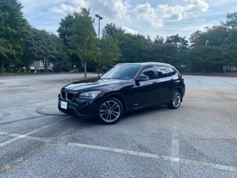 2014 BMW X1 for sale at Uniworld Auto Sales LLC. in Greensboro NC