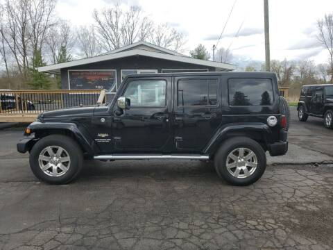 2013 Jeep Wrangler Unlimited for sale at Drive Motor Sales in Ionia MI