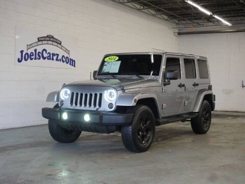 2014 Jeep Wrangler Unlimited for sale at JOELSCARZ.COM in Flushing MI