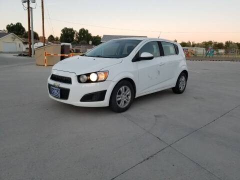 2012 Chevrolet Sonic for sale at KHAN'S AUTO LLC in Worland WY