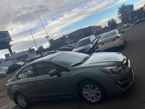 2016 Subaru Impreza for sale at Sanaa Auto Sales LLC in Denver CO