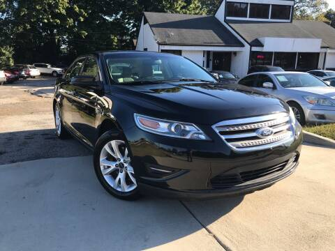 2011 Ford Taurus for sale at Alpha Car Land LLC in Snellville GA