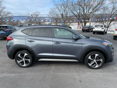 2018 Hyundai Tucson for sale at MAGNUM MOTORS in Reedsville PA