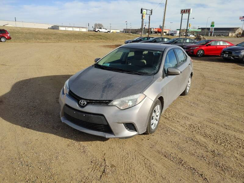 2014 Toyota Corolla for sale at BERG AUTO MALL & TRUCKING INC in Beresford SD