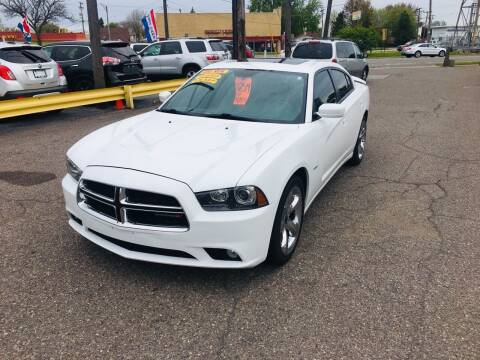 2013 Dodge Charger for sale at Big Three Auto Sales Inc. in Detroit MI