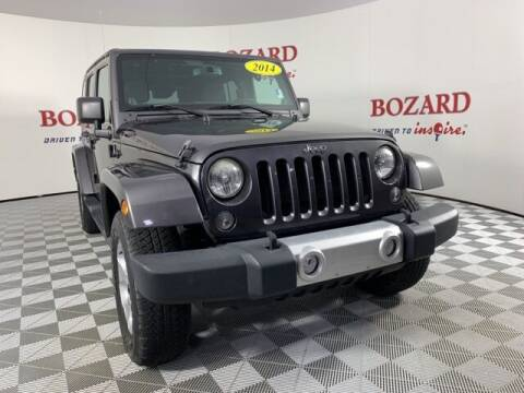 2014 Jeep Wrangler Unlimited for sale at BOZARD FORD in Saint Augustine FL