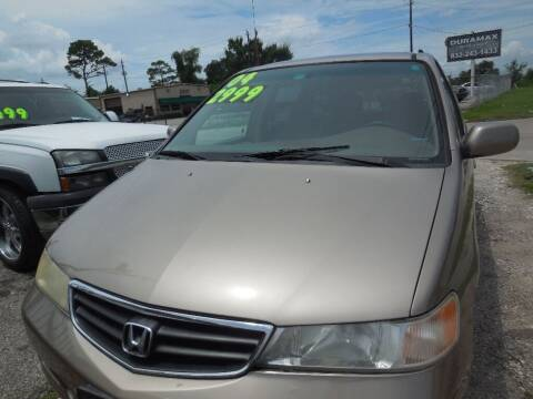 2004 Honda Odyssey for sale at SCOTT HARRISON MOTOR CO in Houston TX