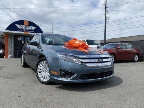 2012 Ford Fusion Hybrid for sale at OTOCITY in Totowa NJ