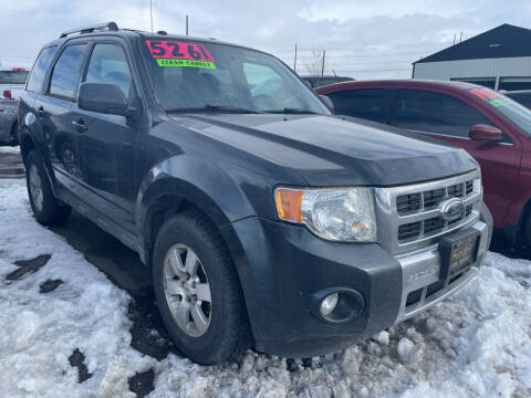 2009 Ford Escape for sale at BELOW BOOK AUTO SALES in Idaho Falls ID