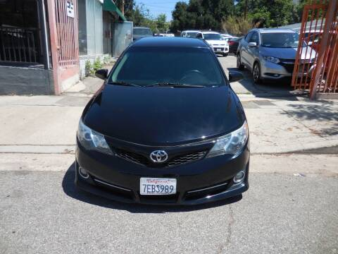 2014 Toyota Camry for sale at ARAX AUTO SALES in Tujunga CA