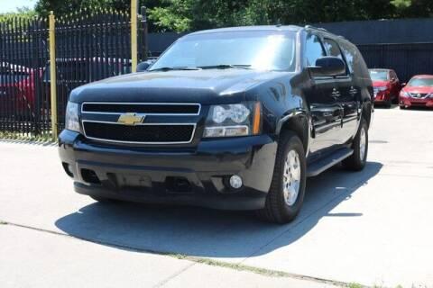 2013 Chevrolet Suburban for sale at F & M AUTO SALES in Detroit MI