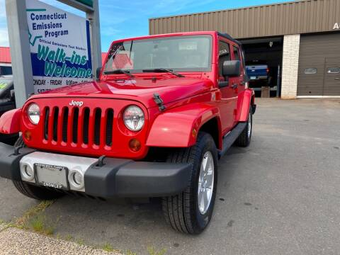 2011 Jeep Wrangler Unlimited for sale at Story Brothers Auto in New Britain CT