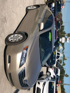 2009 Toyota Camry Hybrid for sale at Marvin Motors in Kissimmee FL