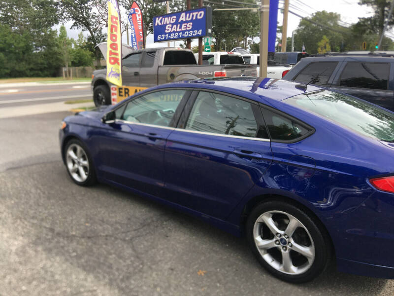 2013 Ford Fusion for sale at King Auto Sales INC in Medford NY