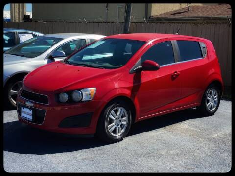 2013 Chevrolet Sonic for sale at ASTRO MOTORS in Houston TX