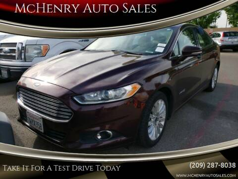 2013 Ford Fusion Hybrid for sale at MCHENRY AUTO SALES in Modesto CA