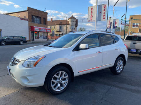 2011 Nissan Rogue for sale at Latino Motors in Aurora IL