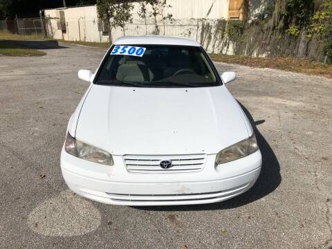 1999 Toyota Camry for sale at Louie's Auto Sales in Leesburg FL