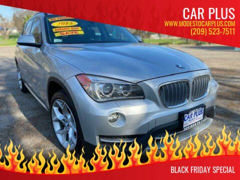 2013 BMW X1 for sale at CAR PLUS in Modesto CA