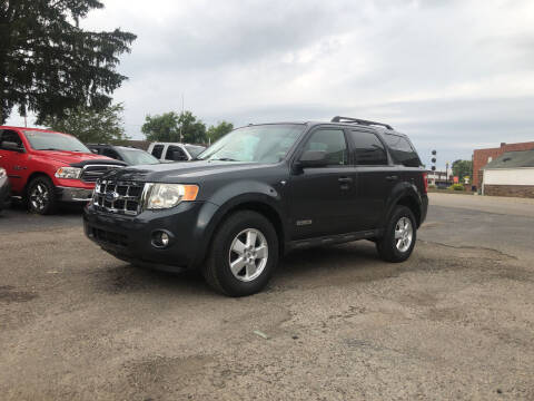 2008 Ford Escape for sale at Jim's Hometown Auto Sales LLC in Byesville OH