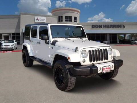 2016 Jeep Wrangler Unlimited for sale at Don Herring Mitsubishi in Plano TX