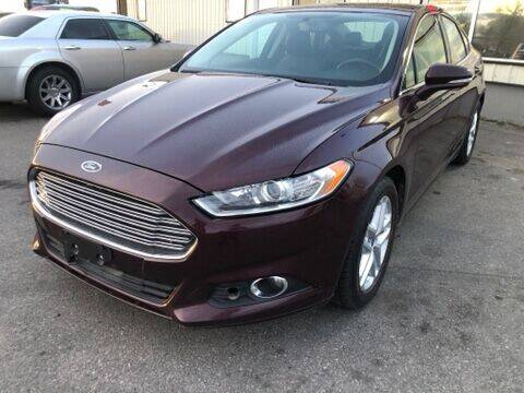 2013 Ford Fusion for sale at BELOW BOOK AUTO SALES in Idaho Falls ID