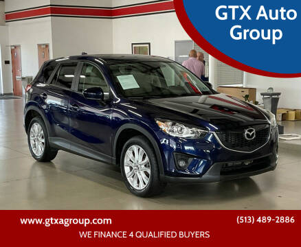 2013 Mazda CX-5 for sale at GTX Auto Group in West Chester OH