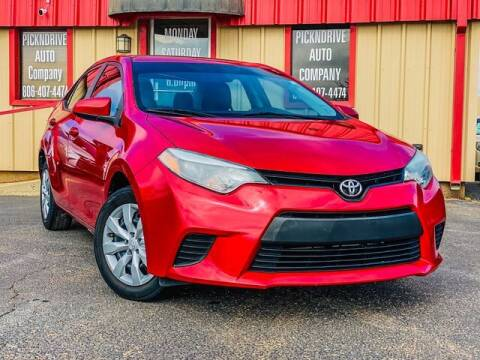 2014 Toyota Corolla for sale at MAGNA CUM LAUDE AUTO COMPANY in Lubbock TX