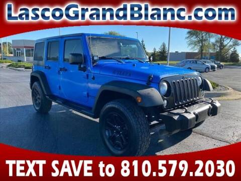 2015 Jeep Wrangler Unlimited for sale at Lasco of Grand Blanc in Grand Blanc MI