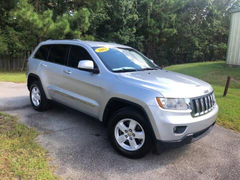 2012 Jeep Grand Cherokee for sale at J. MARTIN AUTO in Richmond Hill GA