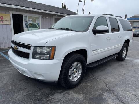 2011 Chevrolet Suburban for sale at Cars 2 Go in Clovis CA