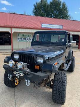 1991 Jeep Wrangler for sale at PITTMAN MOTOR CO in Lindale TX