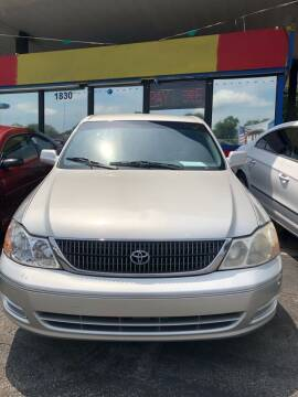 2001 Toyota Avalon for sale at Louie's Auto Sales in Leesburg FL