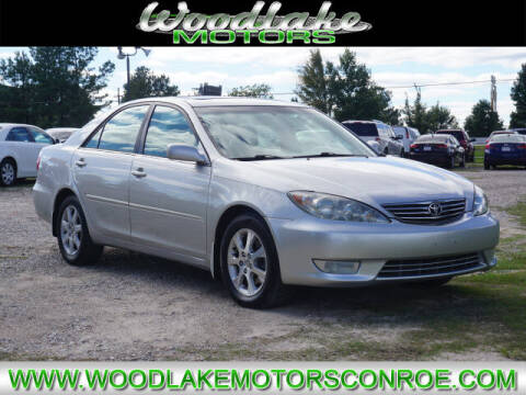2005 Toyota Camry for sale at WOODLAKE MOTORS in Conroe TX
