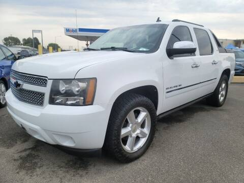 2010 Chevrolet Avalanche for sale at Artistic Auto Group, LLC in Kennewick WA