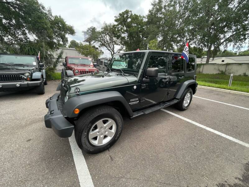 2010 Jeep Wrangler Unlimited for sale at Bay City Autosales in Tampa FL