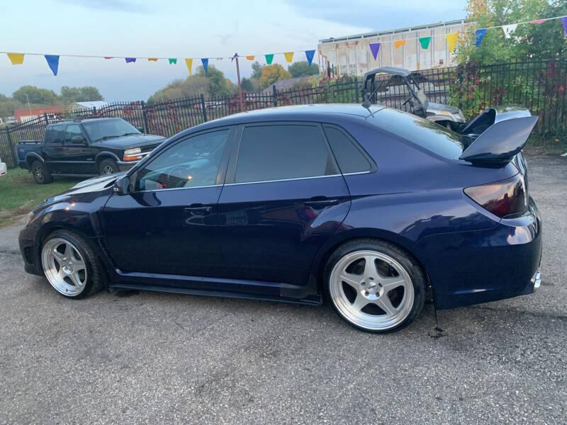 2011 Subaru Impreza for sale at Los Arreglados Auto Sales in Worthington MN