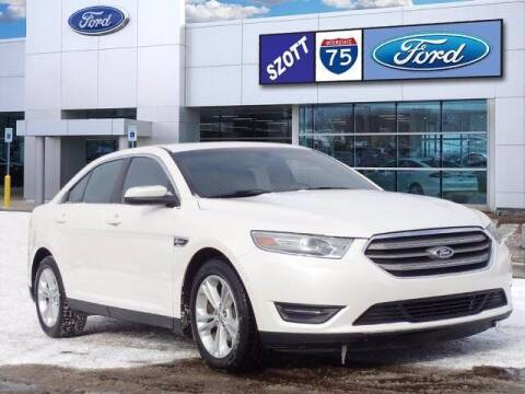 2014 Ford Taurus for sale at Szott Ford in Holly MI