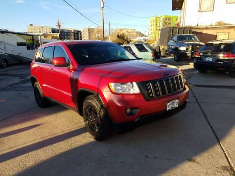 2011 Jeep Grand Cherokee for sale at BERKENKOTTER MOTORS in Brighton CO