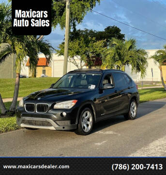 2014 BMW X1 for sale at Maxicars Auto Sales in West Park FL