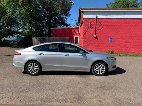 2014 Ford Fusion for sale at WB Auto Sales LLC in Barnum MN