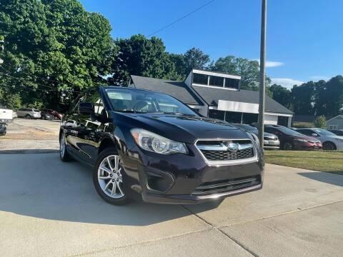 2012 Subaru Impreza for sale at Alpha Car Land LLC in Snellville GA