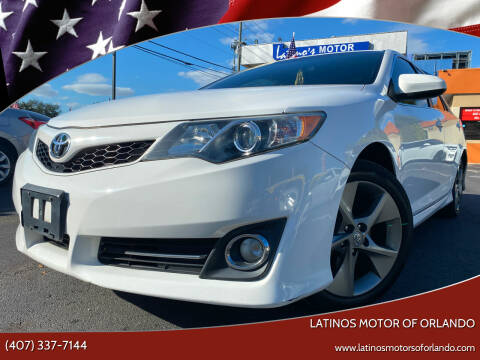 2014 Toyota Camry for sale at LATINOS MOTOR OF ORLANDO in Orlando FL