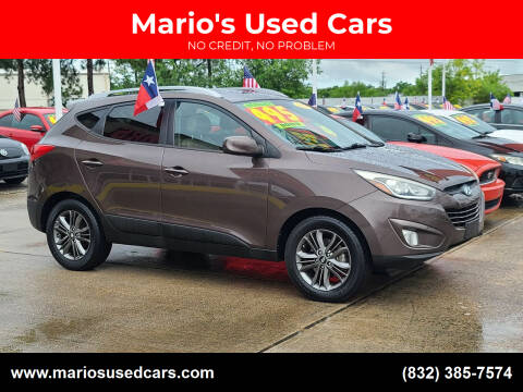 2014 Hyundai Tucson for sale at Mario's Used Cars in Houston TX