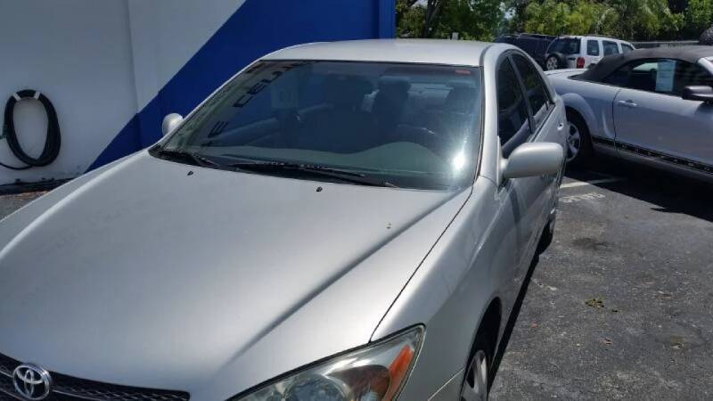 2002 Toyota Camry for sale at AUTO CARE CENTER in West Palm Beach FL