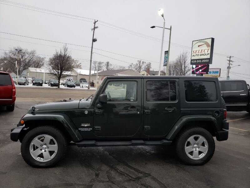 2011 Jeep Wrangler Unlimited for sale at Select Auto Group in Wyoming MI